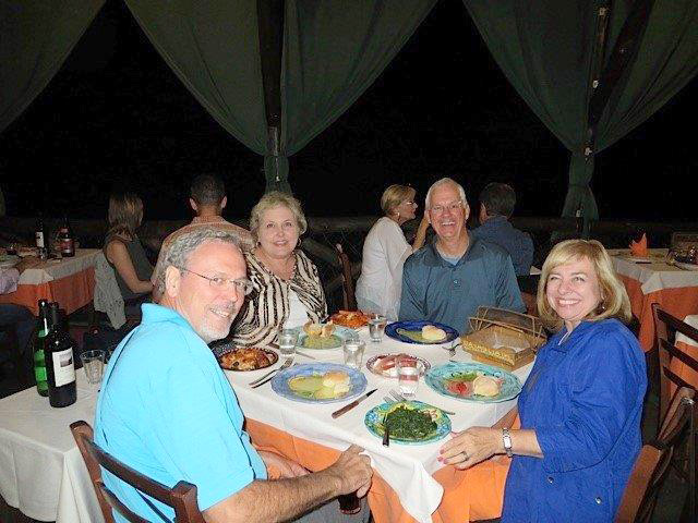 Connie, her husband, and her friends at dinner.